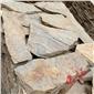 黄木纹板岩碎拼照片 石块砌墙